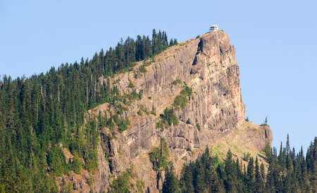 sawtooth national forest: A sharp high ridge holds a historic building used for fire spotting Stock Photo