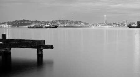 Serene Night Time Scene Pilings Barges Puget Sound in Seattle