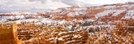rock formation: Fresh snow falls in Bryce Canyon in late November Stock Photo