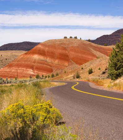 The road winds through colorful mineral and rock deposits in Oregon