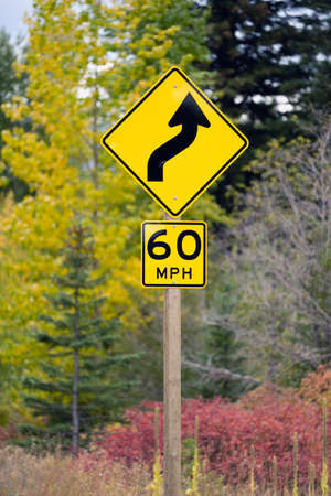 Road Sign indicates conditions to come and speed limit Stock Photo