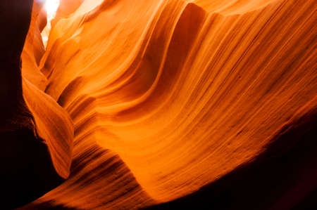Sandstone takes on even more gold color as light streams in from above Stock Photo