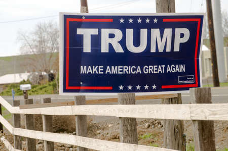 A resident has posted a Trump support sign above the fence