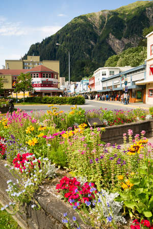 JUNEAU, ALASKAUNITED STATES – AUGUST 5: Tourists walk the street in downtwon towards the end of the summer season on 08052015 in Juneau, AK.