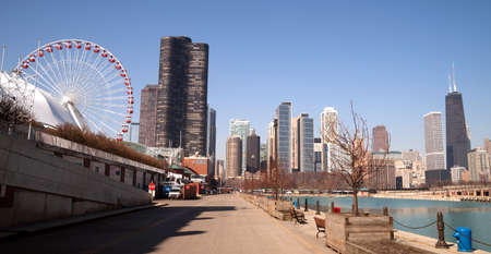 hancock: CHICAGO, ILLINOISUNITED STATES – April 1: Navy Pier with its carnival ride and view of the downtown city skyline 04012015 in Chicago, Illinois.