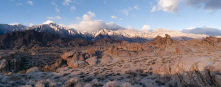 White clouds make a perfect backdrop to bounce color down into this landscape of the Alabama Hills and the Sierra Nevada Range