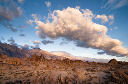 A big beautiful white cloud mass passes over the Alabama Hills in California Stock Photo
