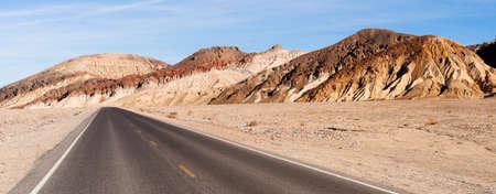 cielos abiertos: Beautiful day clear blue skies and open road in Death Valley Foto de archivo
