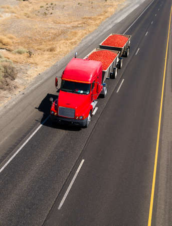 perishable: A big red dual freight hauler carries food to market
