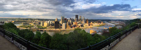 Dramatic skies over Pittsburghs rivers and bridges Stock Photo