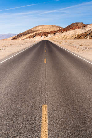 Beautiful day clear blue skies and open road in Death Valley Stock Photo