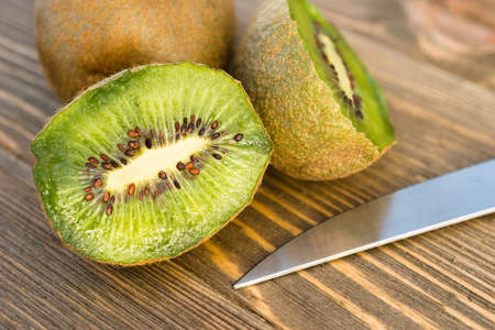 nourishing: Two Kiwi Fruits sit on the cutting board