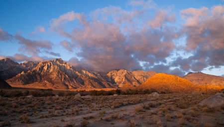 Orange hues cover mountains and clouds sunset Alabama Hills
