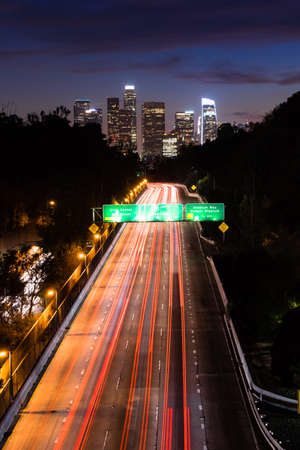 Long exposure brake lights trail on into downtown Los Angeles California