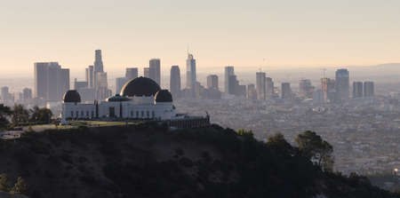 The obseratory dominates the forground with the city skyline of Los Angeles in the background