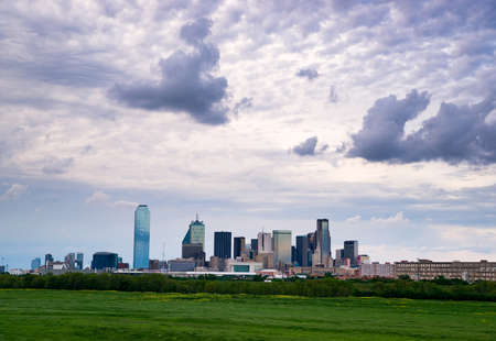 A lush green beltway appears in front of the urban landscape of Houston, TX USA Reklamní fotografie