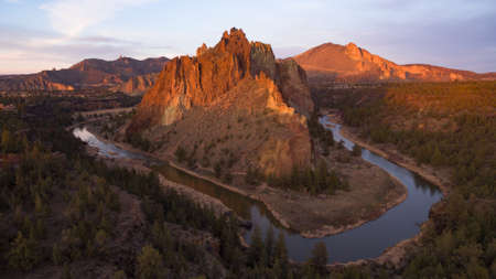 The sun is setting on Smith Rock in Central Oregons high desert Stock Photo