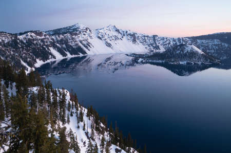 Stillness in the water and clear skies in Crater Lake National Park Oregon State North America