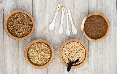 A scoop sits in the Pearl Barley, Groats and Red Wheat raw food superfoods