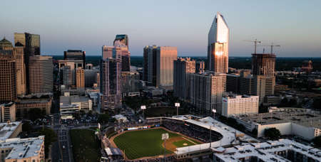 Aerial view of the skyscrapers and a stadium  in the urban city center of Charlotte, North Carolina