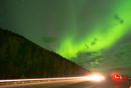 The night sky near Valdez Alaska lights up with a spectacular showing of the Aurora Borealis Stock Photo