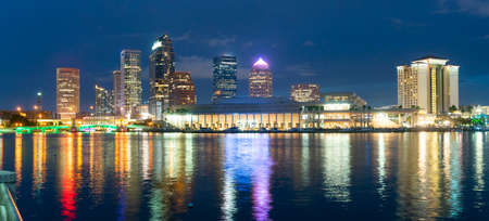 Night falls as lights come up on buildings beginning a beautiful summer evening in Tampa Florida downtown Editorial