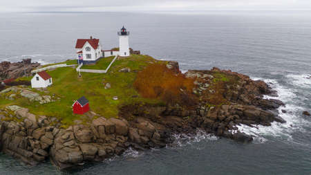 The red beacon of nubble Light warns mariners of dangerous rocks and surf on the Atlantic Ocean East Coast