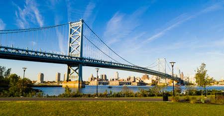 Blue sky over the Benjamin Franklin Bridge into downtown Philadelphia Pennsylvania