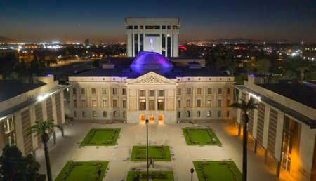 Blue light illuminates the roof of the Arizona Capitol building in Phoenix USA