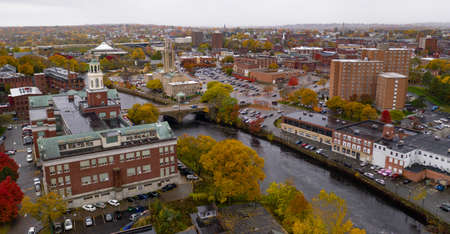 Fall comes to the trees and landscape in the downtown urban core of Pawtucket Rhode Island Imagens