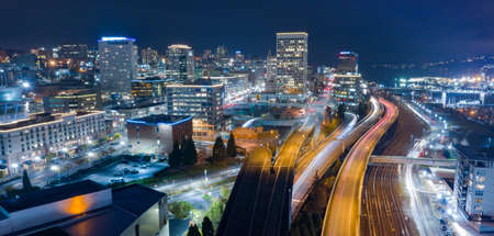 Night scene aerial view over the highway and buildings of downtown Tacoma Washington