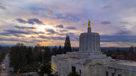 The state capital building adorned with the Oregon Pioneer with downtown Salem in the background Editorial