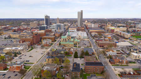 Colorful buildings businesses and churches line up by streets in this aerial view of Fort Wayne Indiana