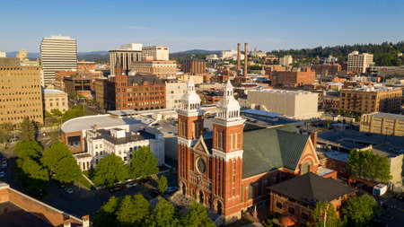 Rich late afternoon light falls onto the buildings and architecture of Spokane Washington USA