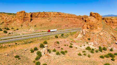 Big Rigs and vacation tavelers drive along the highway in the desert southwest Stock Photo