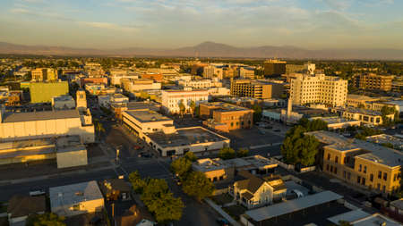 The southern city center downtown area of Bakersfield aerial view illuminated by late afternoon light