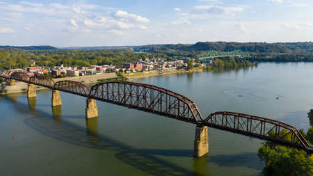 Looking across the Ohio River into downtown Point Pleasant over an old railroad bridge trestle