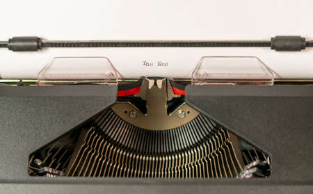 An almost obsolete tool for writing the typewriter here with The End typed out
