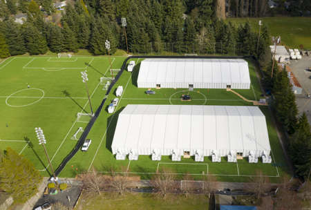2 100 bed tents for Corona Virus patients are set up on a soccer field