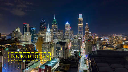 Aerial view night sky over the neighborhoods and streets of Philadelphia PA USA Reklamní fotografie