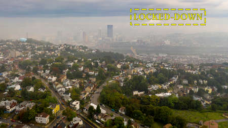 A thick layer of fog still has not burned off over downtown Pittsburgh and suburbs