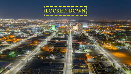 Illuminated streets lead travelers into Albuquerque New Mexico before sunrise