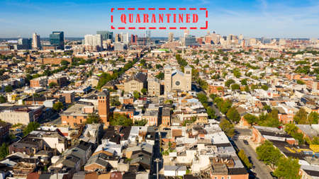 Row houses churches parks and businesses exhist locked down in the expansive city of Baltimore Reklamní fotografie