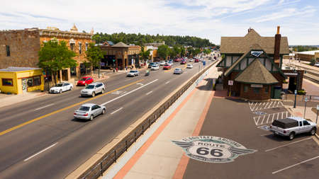 Flagstaff, Arizona/USA- August 28, 2019: Traffic makes it's way past the train station along route 66 in Flagstaff, Arizona USA 2019