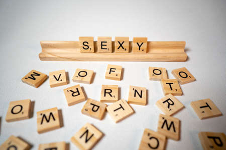 White background letter pieces spell out the word Sexy