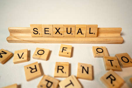 Tray and Block Letters Say Sexual on White