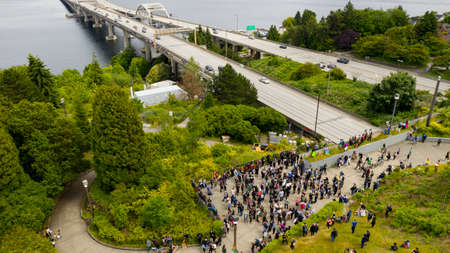 The local football team players wives organized a march from Mercer Island to Seattle and back
