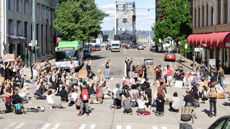 Tacoma, WA/USA  June 1: Street View Protesters create a Mob Scene blocking an intersection for George Floyd and the BLM in Tacoma June 1, 2020 Editoriali