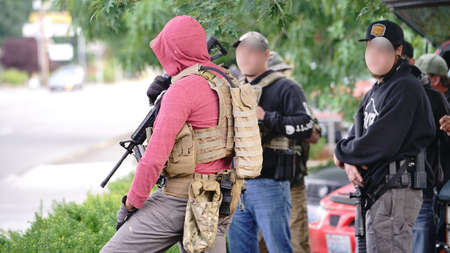 Auburn, WA/USA – June 2: Street View armed men gather with automatic weapons as protesters gather at City Hall to March for George Floyd Auburn on June 2, 2020