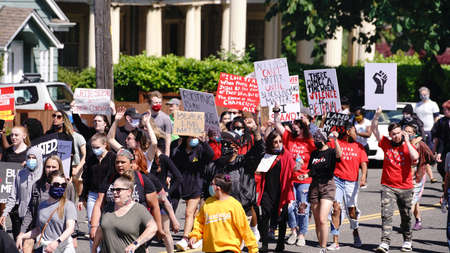 Tacoma, WA/USA  June 1: Street View Young Protesters march blocking intersections for George Floyd and the BLM in Tacoma June 1, 2020